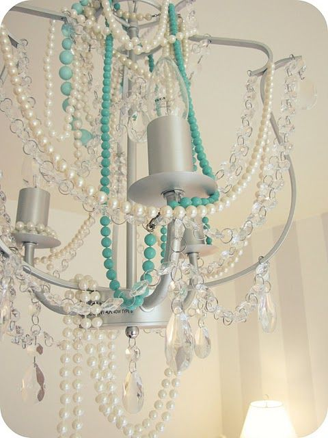 This is a chandelier from IKEA with additional pearl strands draped on it. Good idea if you change color schemes frequently!
