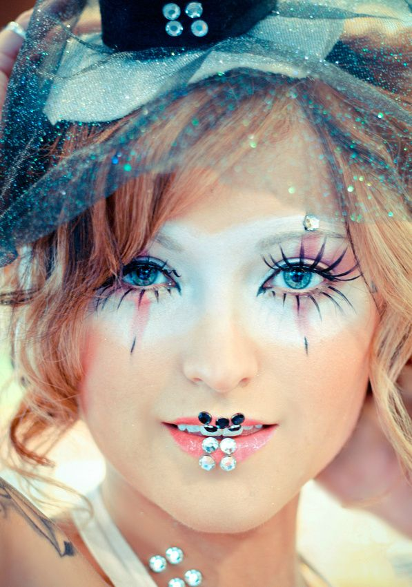 Circus Girl makeup enhanced with crystals, top hat & veil along with bejeweled lips.