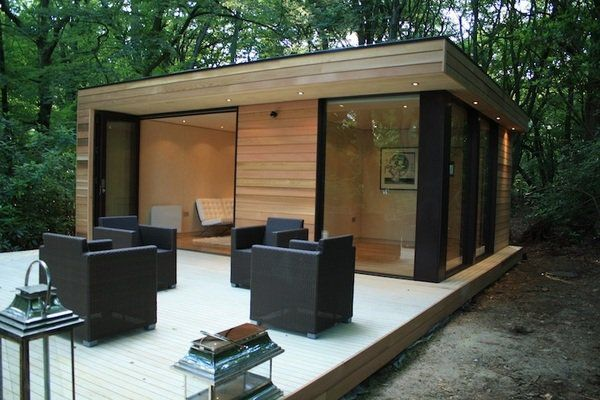 modern garden shed design large windows wooden deck outdoor furniture