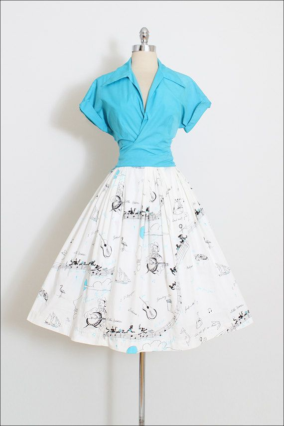 ➳ vintage 1950s skirt and top * amazing rare Songs of the Islands novelty print * Little Nassau, Bahama Mama, JP Morgan, etc * turquoise blue cotton wrap top * metal side zipper skirt with pleating * by Nassaus Mademoiselle condition   excellent fits like m/l skirt: length 27 waist 27 (2 button allowance) top: length 20 bust 34-38 waist 28-32 ➳ shop http://www.etsy.com/shop/millstreetvintage?ref=si_shop ➳ shop policies http://www.etsy.com/sh...