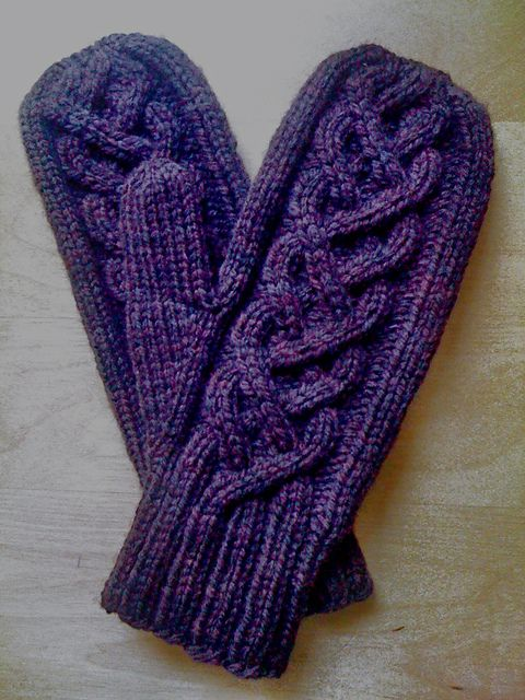I've always wanted to try to knit mittens, and I love cables.  This pattern might be the winner!