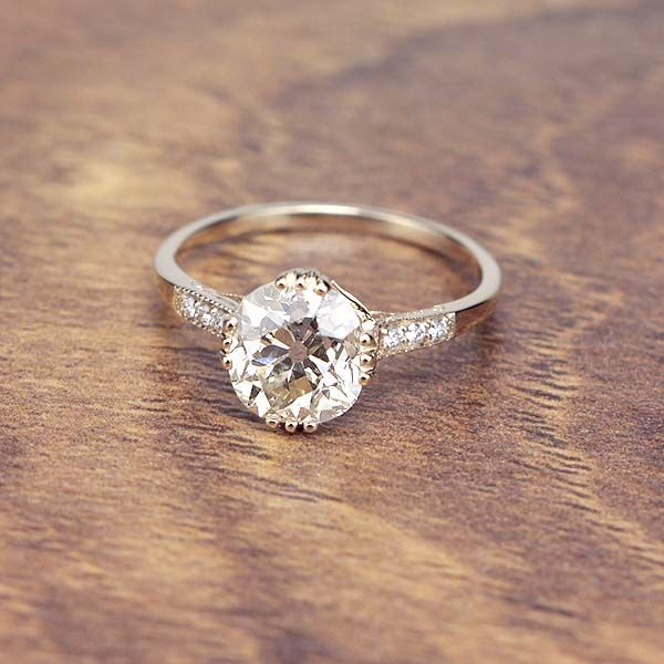 Interesting prongs and I like the side diamonds. A slightly wider band might be better. Replica Edwardian Engagement ring set with an Antique Diamond. - 3144-10