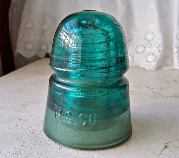 vintage green glass insulator h g co