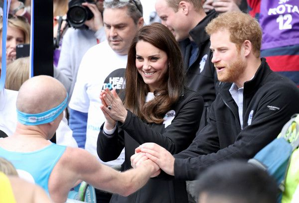 Catherine, Duchess of Cambridge and Prince Harry cheer on runners during the 2017 Virgin Money London Marathon on April 23, 2017 in London, England. The Duke and Duchess of Cambridge and Prince Harry, are spearheading Heads Together, in partnership with eight leading mental health charities, that are tackling stigma, raising awareness, and providing vital help for people with mental health problems.