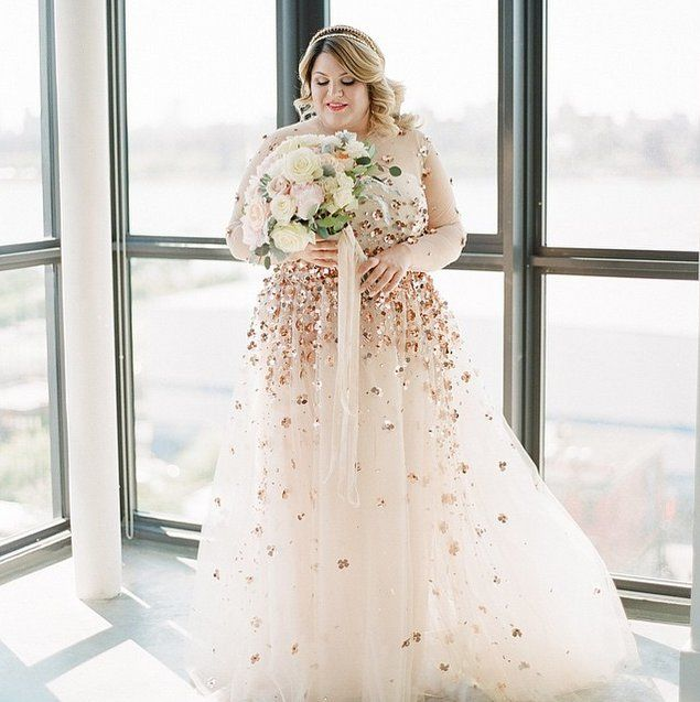 Pin for Later: 16 Breathtaking Wedding Dresses Worn by Your Favourite Bloggers  Nicolette Mason went sheer in a classy way, wearing a gown designed for her by Christian Siriano.
