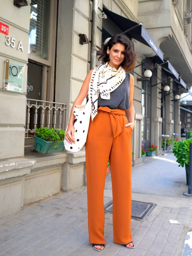 high waisted pants & scarf combo are classic with an orange twist via Face Hunter