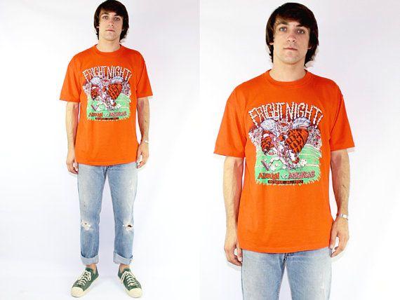 Auburn vs Arkansas Orange Fright Night Halloween Orange Short Sleeve T-Shirt XL Vintage Dark Orange Tee Shirt Football Game Tee Halloween by DiveVintage from Passport Vintage. Find it now at http://ift.tt/2ea7nD7!