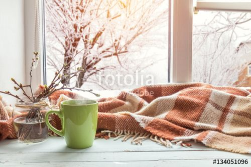 """Download the royalty-free photo """"Cup of coffee, books, branch of cherry tree, wool blanket on windowsill. In the background snow tree pattern on window. Cozy home concept."""" created by Victoria Kondysenko at the lowest price on Fotolia.com. Browse our cheap image bank online to find the perfect stock photo for your marketing projects!"""