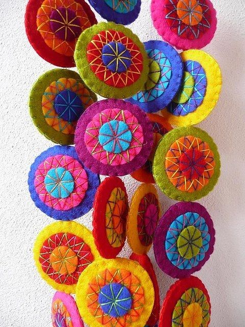 LakeTyeDye says: Pretty little felt circles can be used to make any part of a room colorful! Use crazy-quilting stitches to make them mandala-like, too.
