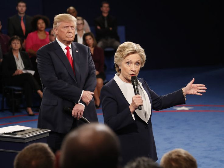10/09/16 The Second Presidential Debate In 100 Words (And 6 Videos) : The Two-Way : NPR  Democratic presidential nominee Hillary Clinton speaks as Republican presidential nominee Donald Trump listens during the second presidential debate at Washington University in St. Louis, on Sunday. Rick T. Wilking/AP