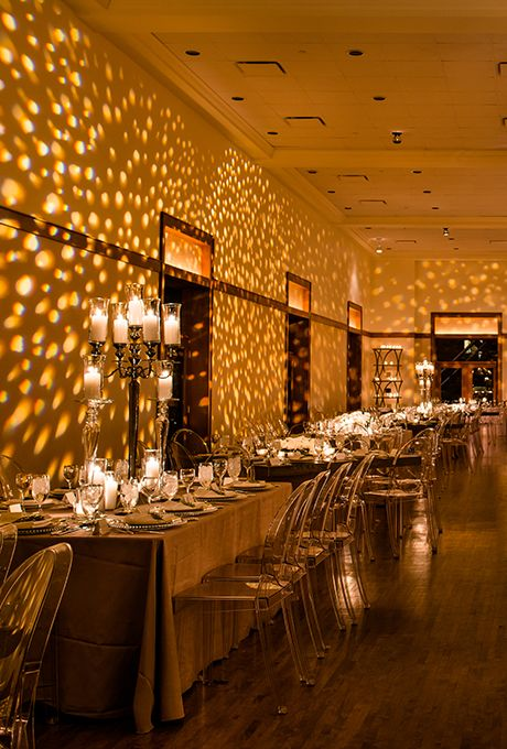 Brides.com: . This sleek and modern wedding reception looks like it was made of gold, thanks to a dazzling pattern projected onto the walls.