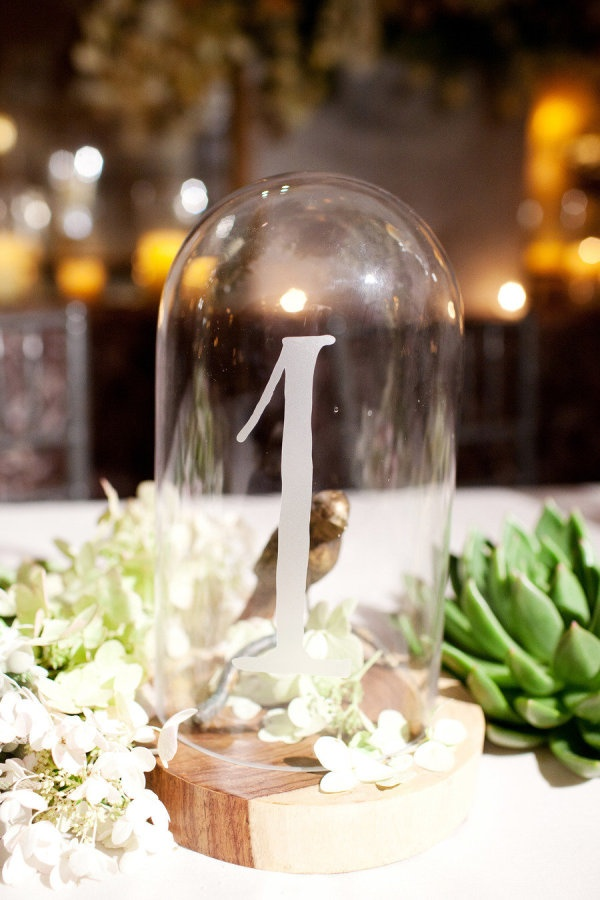 Numbers in bell jars. Like. Photography by perezweddings.com, Planning, Floral   Event Design by toddevents.com