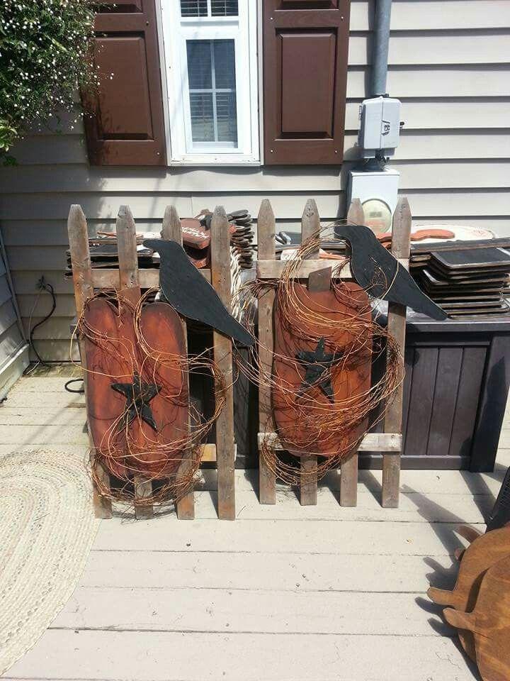 Prim Wood Pumpkins on a Picket Fence                              …
