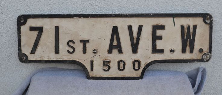 VINTAGE 1 st. Ave. W. 1500 metal double sided street sign