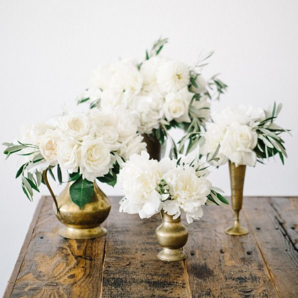 Gold antique vases and white flowers: http://www.stylemepretty.com/living/2015/07/02/a-sophisticated-twist-on-red-white-blue/ | Photography: Steve Steinhardt - http://www.stevesteinhardt.com/