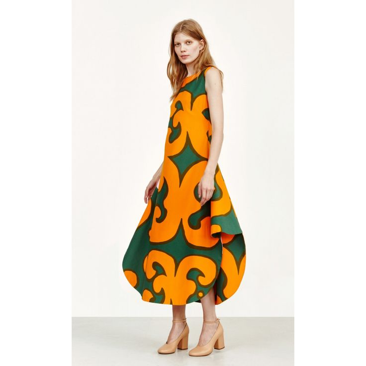 The large-scale Keidas print—a classic designed by Annika Rimala—covers this sleeveless dress with a rounded mid-calf hemline. It's made of woven cotton, has a hidden back zip closure, and a loose straight cut that flares at the hip side gussets. Please n