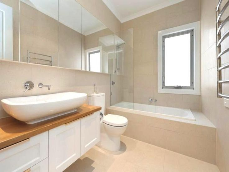 Recessed bath, timber top, large basin. Don't like white cupboards