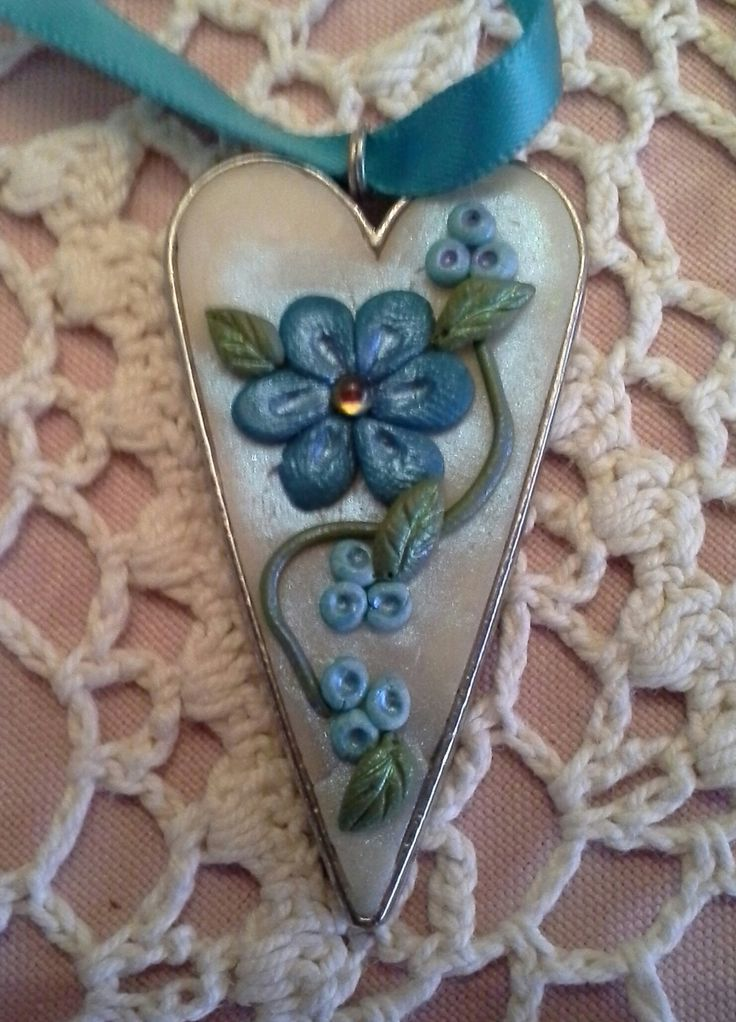 Pendant made with polymer clay.