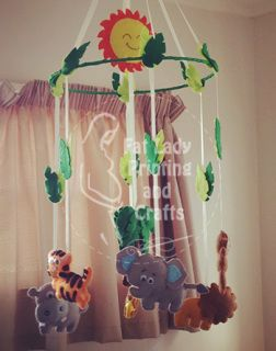 This mobile consists of a bamboo ring with a selection of jungle animals hanging below it to create a bright colourful hanging for your precious little one to gaze at from their cot and adds a nice touch of colour to brighten up the nursery.  Each animal is made from quality wool/acrylic blend felt, and is hand stitched together and stuffed with polyfill, they are strung up with strong ribbon. This makes them light weight so they gently move around in a soft breeze or when touched which…