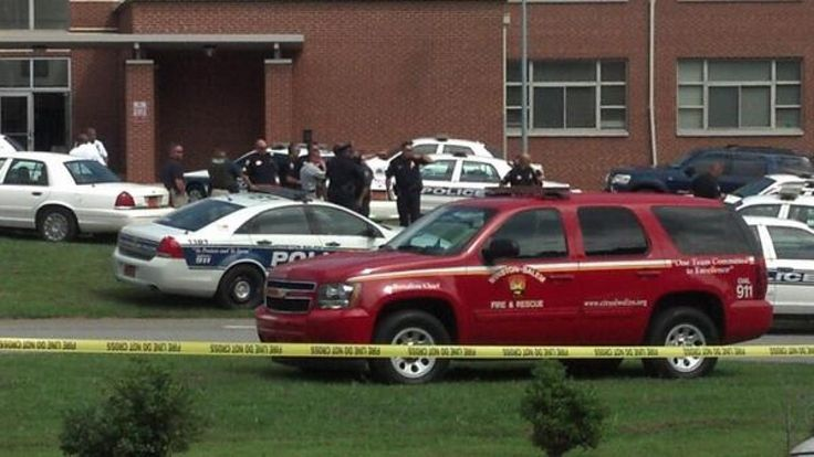 A suspect is in custody after a shooting at Carver High School in Winston-Salem, N.C., police say. A 15-year-old was shot in the neck and shoulder Friday afternoon, News 14 Carolina reports, but the injuries are not life-threatening and the student is conscious and alert.
