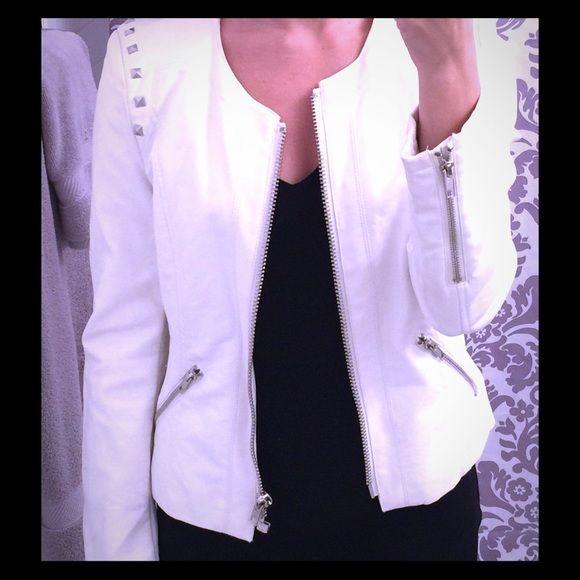 White leather jacket White leather jacket with silver detail. Zip pockets on side, front zip. Leopard lining. Like new! Jackets & Coats Utility Jackets