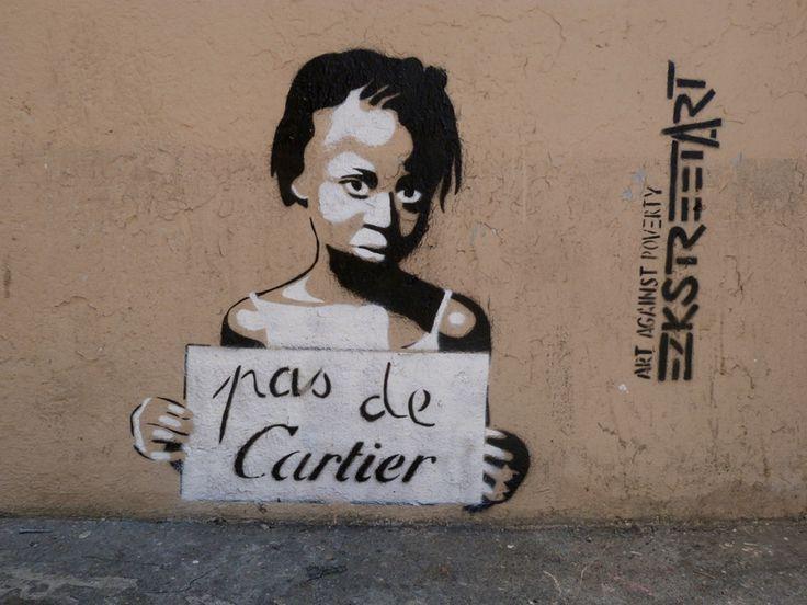 Le luxe n'est-il pas d' avoir assez pour aider les autres ? / Street art. /  Art again poverty. / By Ezk.