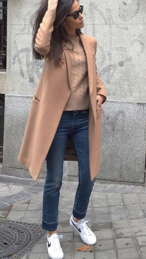 Camel coat, sweater, skinnies, and sneakers