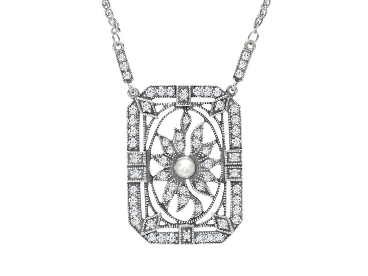 An intriguing, vintage-inspired design will make a stunning statement. This Van Kempen necklace set in sterling silver features intricate geometric patterning studded with sparkling Swarovski crystal and a luminous freshwater pearl. Piece measures 1 1/4 by 7/8 inches with a total length of 16 3/4 inches.