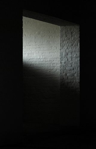 Light and shadow on white rendered bricks. The scarcely lit interior of the magnificent Benedictine abbey in Vaals, The Netherlands designed by the monk/architect Dom Hans van der Laan. Photo by 010lab.