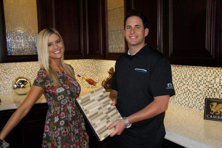 The dynamic duo of flipping houses, Christina and Tarek el Moussa, show off a piece of tile on HGTV's Flip or Flop.