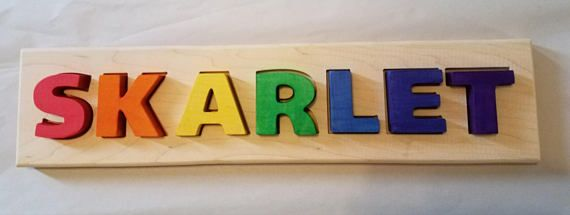 Name puzzle is made from 3/4 thick maple wood. Letters are approximately 2 tall and are made from maple wood and stained with non toxic water based stain