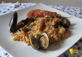 Risotto alla pescatora (ricetta classica). Tutti i segreti per preparare un risotto di mare a regola d'arte con gamberi gamberoni, calamari, cozze e vongole