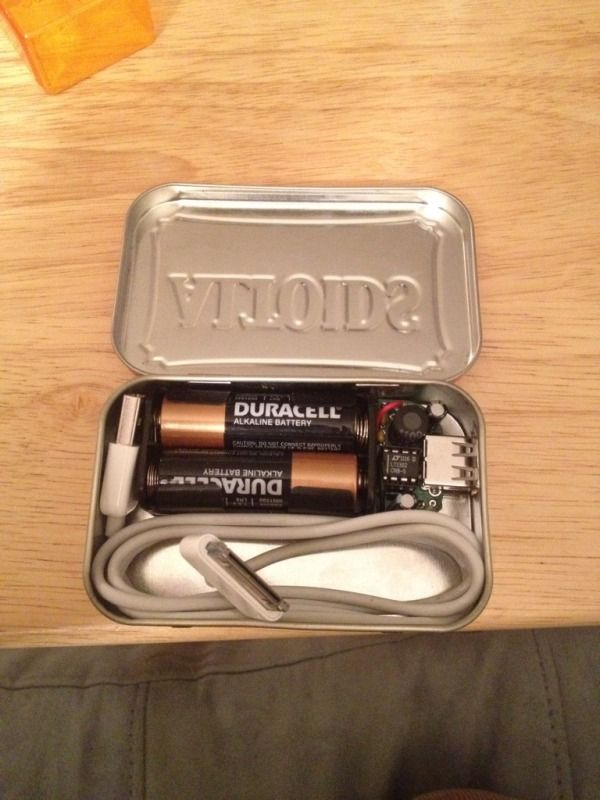 Portable phone charger made out of an altoids case, usb port, and two double A batteries.