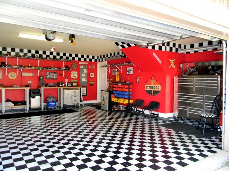 This garage was made specifically for the husband's '57 Chevy truck. There's even a separate room upstairs!
