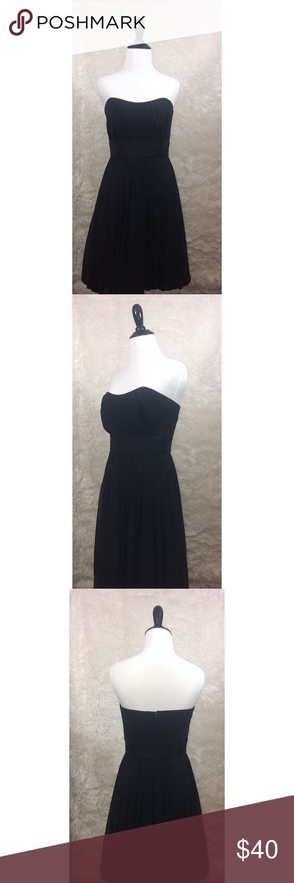 """White House Black Market Strapless Black Dress White House Black Market - Strapless Black Dress - Size 2  Approx Measurements while laying flat:  Armpit to Armpit - 15"""" Waist - 13"""" Length - 28"""" Materials - shell 100% polyester - trim 70% rayon 19% polyester 11% nylon - lining 100% polyester  Flaws - Convertible dress that is supposed to go from strapless to strapped dress, but Is missing one strap (pictured). Can easily be fixed.   Excellent used condition! No stretch. Wired bodice for…"""