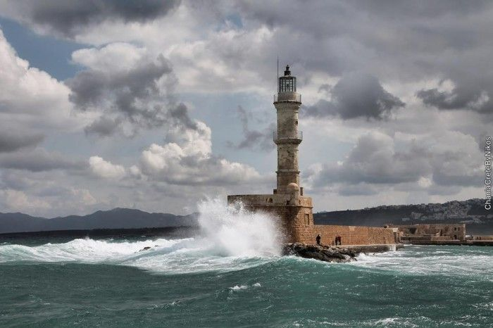 Lighthouse, fall 2015 Chania, Old Harbor, Crete, Greece, waves, October, winter is on its way. Oscar Suites & Village