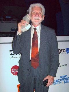 Motorolas Martin Cooper reenacting the worlds first hand-held mobile phone call with the Motorola DynaTAC