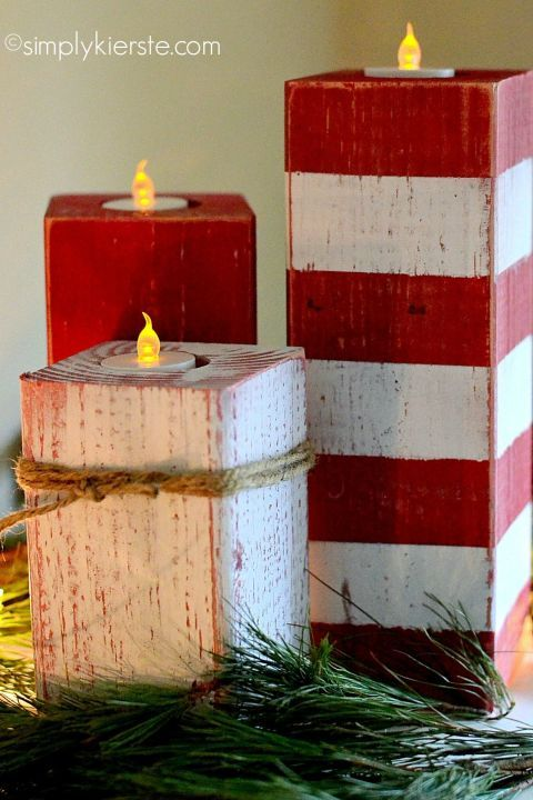 Made using a 4×4 post cut into 3 pieces, frog tape, a drill, and 1 1/2 inch spade bit, sander, and twine, these peppermint candlesticks will freshen up your tablescape this holiday season.   See more at Simply Kierste.