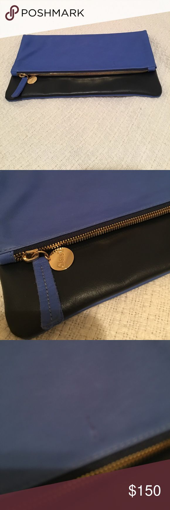 Clare V clutch Chambray lining. Cobalt and navy leather. Beautiful. Carried this twice. There is a slight discoloration on the bag as pictured. Clare Vivier Bags Clutches & Wristlets