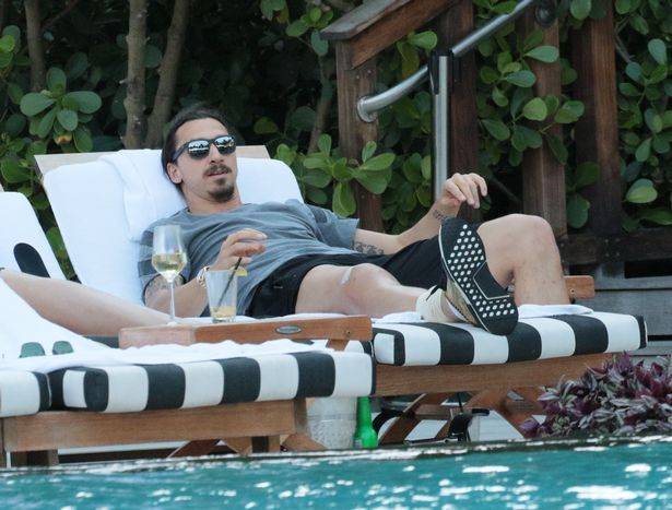 MANCHESTER UNITED STRIKER ZLATAN IBRAHIMOVIC CHILLS WITH PALS AS HE CONTINUES TO RECOVER FROM KNEE SURGERY