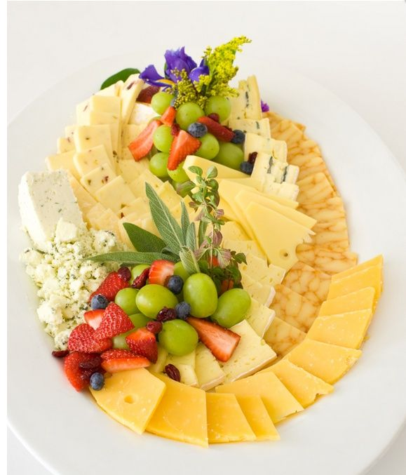A Tapestry of Flavor and Color! An International Selection of Cheeses, Presented on Platters amd Laden with Fresh Fruits and Imported Crackers! Sound good? Yes!