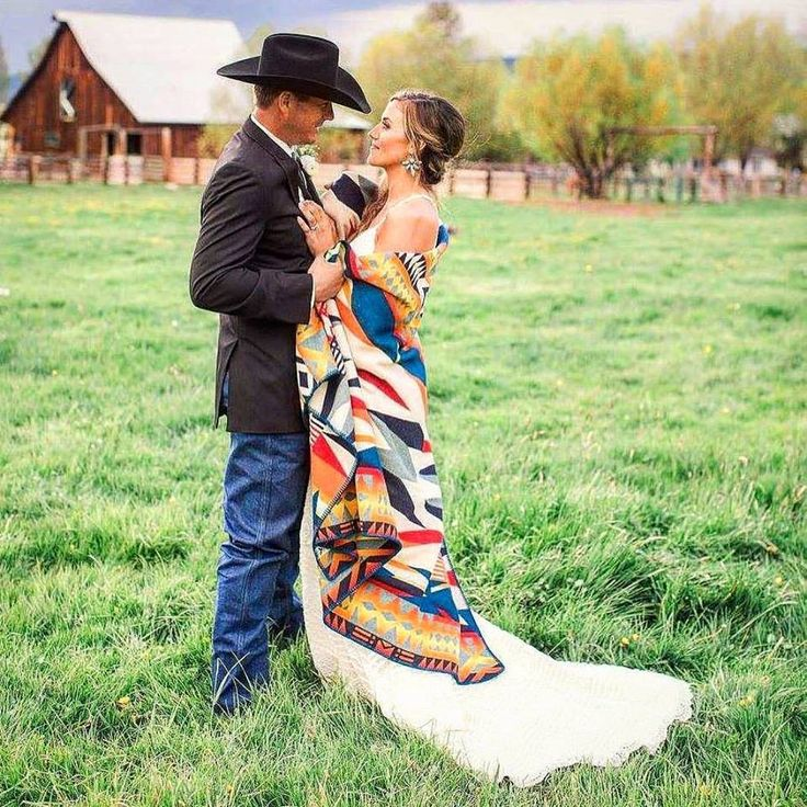 ~ Brit West fb page & Lynne Stroud Dougherty: Newly-wed Jenna Lee Venturacci and her husband.  Customary of the Sioux/Cherokee Natives.  A squaw would stand outside her tipi, with a blanket around her shoulders, awaiting a certain man to walk by. Once he does, and he approaches her, she would open her blanket. If the potential suitor enters her blanket, he is interested in her as a mate... ~