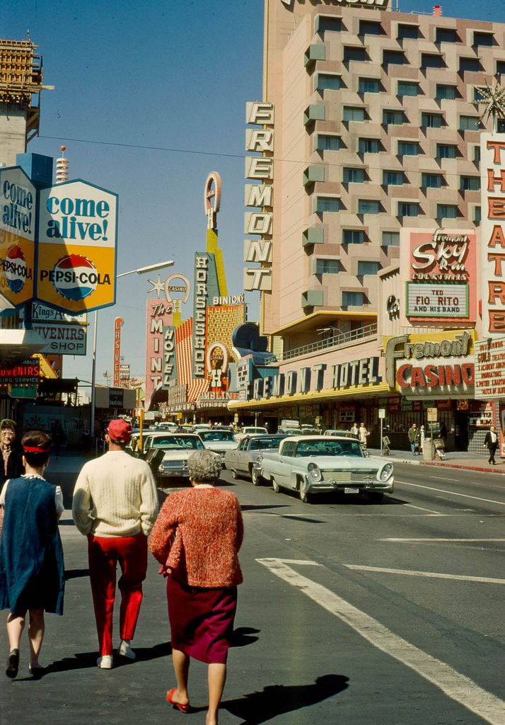 Fremont St, Las Vegas, c. 1964. Ted Rio Fito at the Fremont Hotel Sky Room. The Diplomats at the Golden Nugget. Lucky Casino has just opened next to Diamond Jim's Nevada Club. Photos via Jaap van der Horst