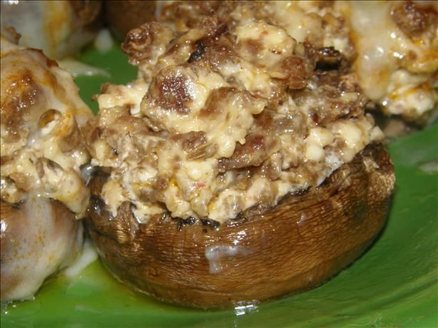 Stuffed Mushrooms With Cream Cheese & Sausage from Food.com:   								I first had these back in high school - too many years ago to think about now.  I've been making them ever since.  Now, whenever any of my friends have a get-together, I'm expected to bring them!  You've been warned!!  They're addictive.