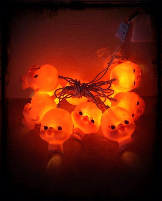 halloween decoration lights delightfully creepy baby doll head string lights by prim and grim on etsy
