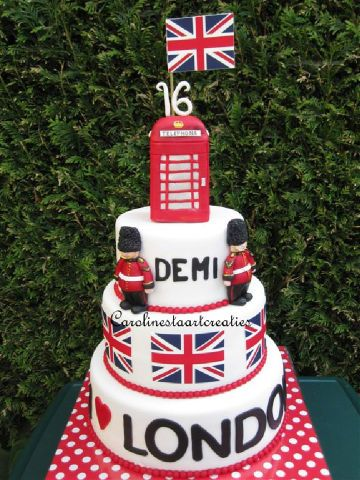 Trying to piece a cake together! **i love Harry** on sides of bottom tier.. **Union Jack** on sides of top tier..