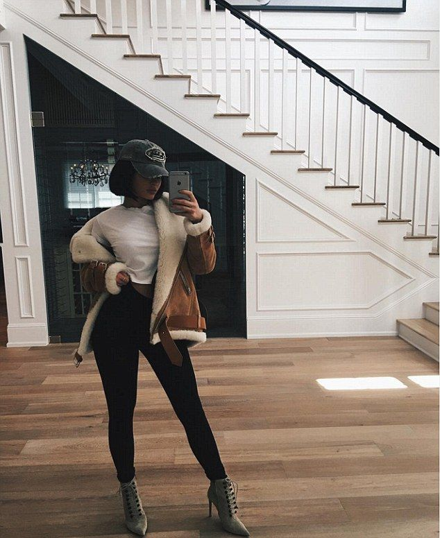 Outfit of the day: Though she was spotted in Yeezy sneakers, Kylie modeled these daring, lace-up heeled boots in a photo shared to Instagram on Thursday
