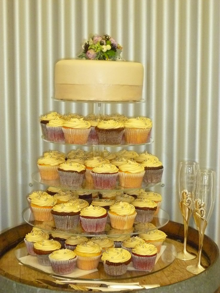 Wedding Cupcake Tower.  Includes large layered mudcake, range of cupcakes including vanilla, chocolate and red velvet. Also includes gluten free cupcakes.