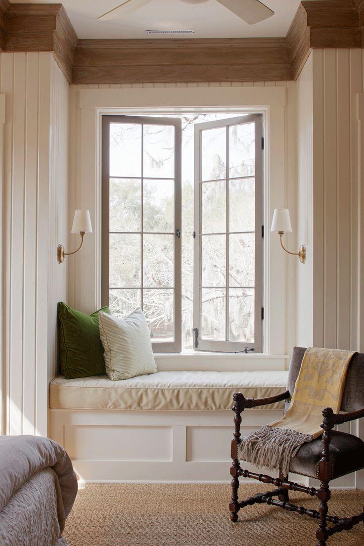White frame Belgian casement window for living