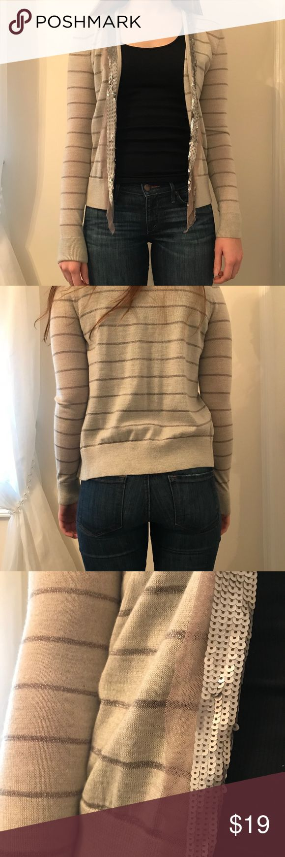 "Ann Taylor Loft Striped Metallic Cardigan Ann Taylor Loft striped metallic cardigan. Detailed sequin lapel, lightweight, worn less then 5 times. Size S, 50% acrylic, 47% wool 1% mohair   Model Measurements: Height: 5' 7"" Hips: 36.5"" Waist: 26.5"" Bust: 31.5"" LOFT Sweaters Cardigans"